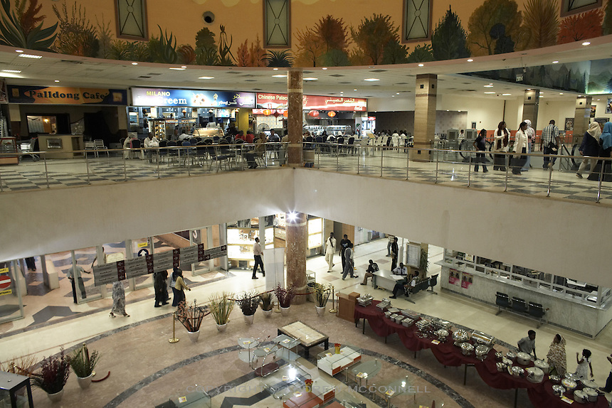The Afra mall in Khartoum, Sudan, on Thursday, Apr. 12, 2007. Khartoum's first mall 'Afra' opened in 2004 and has become popular with affluent Sudanese..Khartoum is modeling itself as the Dubai of Africa and despite Western sanctions the city is booming. Away from the troubles and poverty that plaque the rest of Sudan, development in Khartoum is moving at an astonishing rate. Investment from the East, and in particular China, allowed the Sudanese economy to grow by 11% in 2007. This growth is driven largely by oil, with production rising from 63,000 barrels per day in 1999 to over 500,000 barrels today.