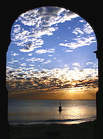 The Cottesloe Beach sunset viewed through the arches underneath the Indiana Restaurant.
