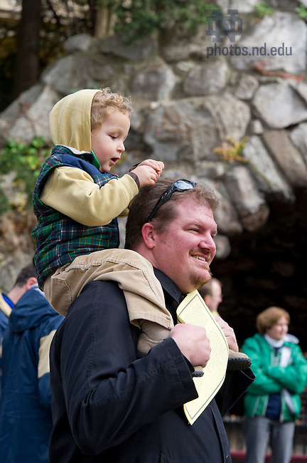 """Nov. 2, 2012; Spectators watch students read from The Divine Comedy during the conclusion of """"Donte Now"""" at the Grotto. Italian Studies at Notre Dame and the College of Arts and Letters' and the William and Katherine Devers Program in Dante Studies hosted """"Dante Now"""" at various locations around campus. Photo by Barbara Johnston/University of Notre Dame"""