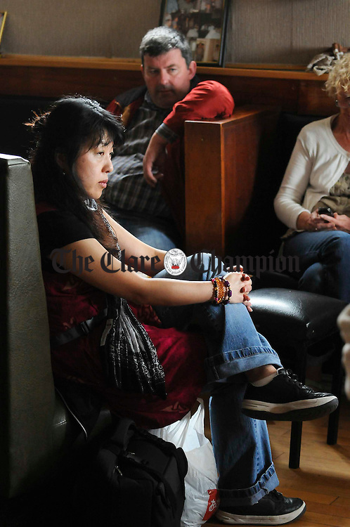 Koko Miyazawa of Japan listening to the music at one of the singing sessions during the Feakle Trad Festival. Photograph by John  Kelly
