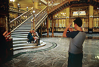 Visitors taking pictures at The Correos (postal service) building which is one of the Jewels of architecture in Mexico City