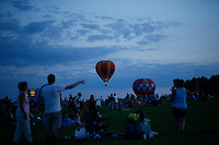 New York, USA. 25 July 2014.  People watch<br />  the 32th annual Balloon festival in Readington, New Jersey. Photo by VIEWpress