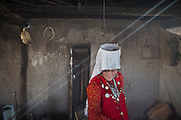 The wife of the Khan in the winter house. .In and around the campment of Kyzyl Qorum, campment of the former deceased Khan, Abdul Rashid Khan..Trekking with yak caravan through the Little Pamir where the Afghan Kyrgyz community live all year, on the borders of China, Tajikistan and Pakistan.