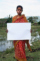 Arti Mandal - 25 yrs.Assam.Hindu.Has three children. Husband is a farmer..'I can't talk about life. Our minds are so occupied by the day to day struggle of our own existence'