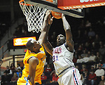 "Ole Miss' Murphy Holloway (31) shoots vs. McNeese State's Desharick Guidry (32) at the C.M. ""Tad"" Smith Coliseum in Oxford, Miss. on Tuesday, November 20, 2012. .."