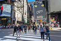 Visitors to busy Times Square in New York on Friday, October 7, 2016.  (© Richard B. Levine)