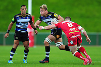 David Denton of Bath Rugby takes on the Scarlets defence. Pre-season friendly match, between the Scarlets and Bath Rugby on August 20, 2016 at Eirias Park in Colwyn Bay, Wales. Photo by: Patrick Khachfe / Onside Images