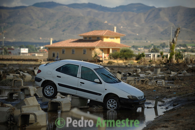 A car is covered with mud in a flooded street of Lorca, near Murcia, southeastern Spain, on September 30, 2012. Ten people in total have died in Spain in the regions of Andalusia and Murcia due to flash flooding brought on by downpours. The heavy rains have also damaged homes, caused the collapse of two bridges and forced roads to close. (c) Pedro ARMESTRE