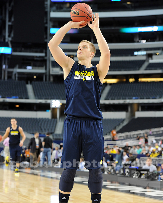 The University of Michigan men's basketball team during Media Day and practice at Cowboys Stadium in Arlington, Texas, on March 28, 2013.