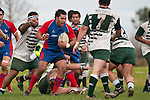 Cody Martin gets surrounded by Manurewa  forwards as he takes the ball forward. Counties Manukau Premier Club Rugby game between Manurewa and Ardmore Marist played at Mountfort Park, Manurewa on Saturday June 19th 2010..Manurewa won the game 27 - 10 after leading 15 - 5 at halftime.