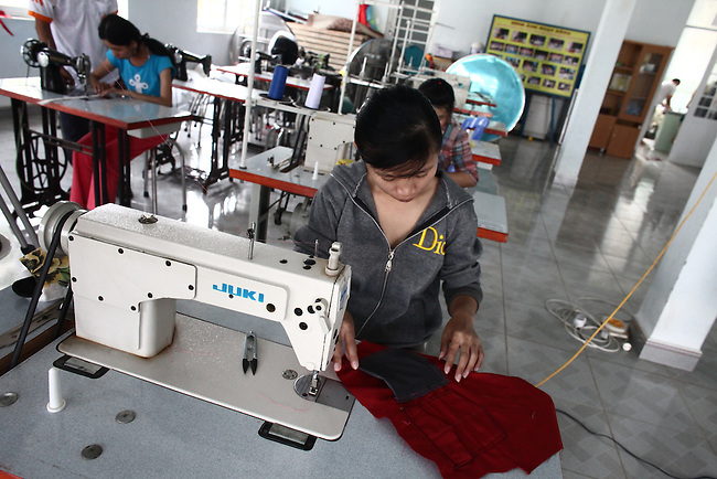 A young woman sews clothes at a day care center for children affected by dioxin exposure near Da Nang, Vietnam. The Da Nang Association of Victims of Agent Orange/Dioxin says that more than 5,000 people -- including 1,400 children -- around the city suffer from mental and physical disabilities caused by dioxin exposure, the result of the U.S. military's use of Agent Orange during the Vietnam War more than 40 years ago. About 200 children attend three centers operated by the group, where they are taught to read and write and socialize with other children. Some young adults are taught how to sew, make incense and handicrafts, with the goal of enabling them to work and make money for themselves and their families. The Vietnam Red Cross says that more than 3 million people suffer from illnesses related to Agent Orange and dioxin exposure, including at least 150,000 children born with severe birth defects since the end of the war. The U.S. government started paying last year to clean up dioxin-contaminated soil at the Da Nang airport, which served as a major U.S. base during the conflict. However, the U.S. government still denies that dioxin is to blame for widespread health problems in Vietnam and has never provided any money specifically to help the country's Agent Orange victims. March 18, 2013.