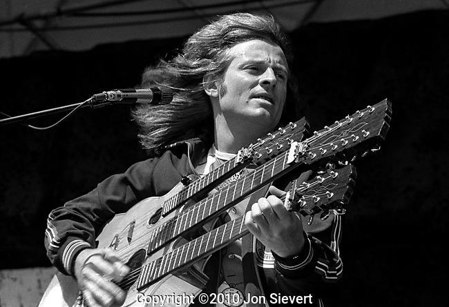 John Paul Jones, 7/23/77, Oakland Coliseum. English multi-instrumentalist musician, composer, arranger and record producer.<br /> <br /> Best known as the bassist, mandolinist, and keyboardist for English rock band Led Zeppelin, Jones has since developed a solo career and has gained even more respect as both a musician and a producer. A versatile musician, Jones also plays guitar, koto, lap steel guitars, autoharp, ukulele, sitar, cello, continuum and the three over-dubbed recorder parts heard on Led Zeppelin's &quot;Stairway to Heaven&quot;.