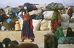 Two Afghan refugee women cross the border into Pakistan near Chaman..