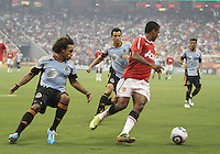 Kevin Alston #30 of the MLS All-Stars loses the ball to Nani #17 of Manchester United during the 2010 MLS All-Star match at Reliant Stadium, on July 28 2010, in Houston, Texas. Manchester United won 5-2.