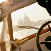 Basilica di Santa Maria della Salute, St Mary of Health, seen from inside a motor boat in Venice, Italy