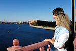 Stock photo of a Young man an a young woman on the bridge enjoying a view on the city Tourism travel and sightseeing concept Look for more photographs from this series Kiev Ukraine The Dnepr river