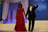United States President Barack Obama (R) and first lady Michelle Obama wave to the crowd during the Commander in Chief Inaugural Ball at the Walter E. Washington Convention Center on January 21, 2013 in Washington, DC. President Obama was sworn in for his second term earlier in the day. .Credit: Alex Wong / Pool via CNP