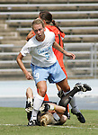 24 September 2006: UNC's Whitney Engen (9) steps over Miami goalkeeper Lauren McAdam (below) after scoring a goal at 58:40. The University of North Carolina Tarheels defeated the University of Miami Hurricanes 6-1 at Fetzer Field in Chapel Hill, North Carolina in an NCAA Division I women's soccer game.