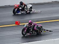 Oct. 8, 2012; Mohnton, PA, USA: NHRA pro stock motorcycle rider Eddie Krawiec (near lane) races alongside Craig Treble during the Auto Plus Nationals at Maple Grove Raceway. Mandatory Credit: Mark J. Rebilas-