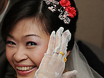Taiwanese Wedding -- The bride showing off her wedding rings.