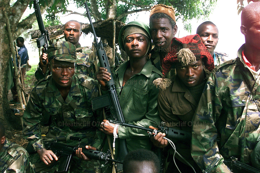Fighters from the notorious Westside Boys at Rogberi Junction after a brief skirmish with RUF forces.<br /> <br /> 21 May 2000, Sierra Leone