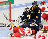 Loose puck! Britt Hergesheimer (BU - 2), Lindsay Hoogstraten (Windsor - 23), Krysten Bortolotti (Windsor - 2) - The Boston University Terriers defeated the visiting University of Windsor Lancers 4-1 in a Saturday afternoon, September 25, 2010, exhibition game at Walter Brown Arena in Boston, MA.
