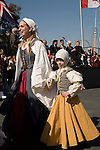 Adults and children historic reenactors in the Grand Parade of Clans at the Scotsfest Scottish Festival and clan gathering at the Queen Mary in Long Beach, CA