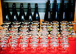 Wine bottles and glasses wait for tasting visitors behind the bar at Philip Carter Winery.