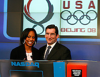 Sanya Richards (Left) poses with Robert Greifeld(Right) President, CEO of NASDAQ at the closing bell on Wednesday, January 2, 2008. Photo by Errol Anderson.