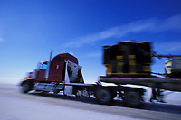 Semi truck speeds by, hauling supplies to Prudhoe Bay Oil fields, James Dalton Highway, Brooks range, Arctic, Alaska