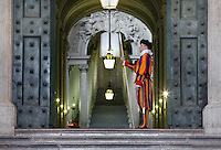 Pontifical Swiss Guard at the Bronze Door, 1949, Saint Peter's Basilica, Vatican City, Rome, Italy. This main entrance to the Apostolic Palace and the papal apartments leads to the marble Scala Regia (Royal Staircase). Picture by Manuel Cohen