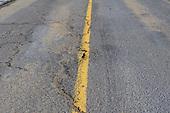 Large crack in asphalt road