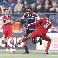Chicago Fire defender Jalil Anibaba (6) disrupts New England Revolution forward Jerry Bengtson (27). In a Major League Soccer (MLS) match, the New England Revolution (blue) defeated Chicago Fire (red), 1-0, at Gillette Stadium on October 20, 2012.