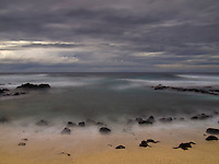 A long exposure image at sunset of Pine Trees Beach on the Big Island.