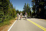 OR:  Oregon; Crater Lake National Park, bicycling, model released           .Photo Copyright Lee Foster, lee@fostertravel.com, www.fostertravel.com, (510) 549-2202.Image orcrat209