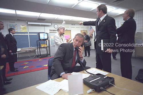 United States President George W. Bush watches video footage of the terrorist attack upon the World Trade Center on New York City from Emma Booker Elementary School in Sarasota, Florida on Tuesday, September 11, 2001.Mandatory Credit: Eric Draper - White House via CNP.