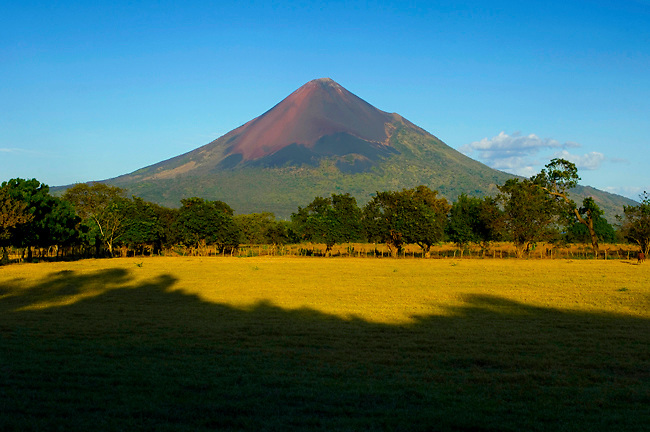 The active Momotombo Volcano at sunset.