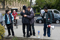 Five days after Election Day a new Government is formed involving the Conservative Party and The Liberal Democratic Party. Photos taken at College Green (Abingdon Street Gardens) in Westminster, London. Photo shows anti-capitalist demonstrators being questioned by the police.