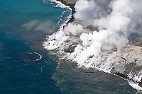 Aerial of Kilauea's lava flowing into the ocean, Kalapana, Big Island.