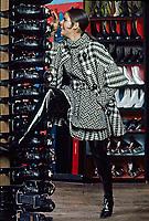 Ali MacGraw models winter fashion in the Princeton Skate and Ski Shop, Princeton, New Jersey, 1967. Photo by John G. Zimmerman