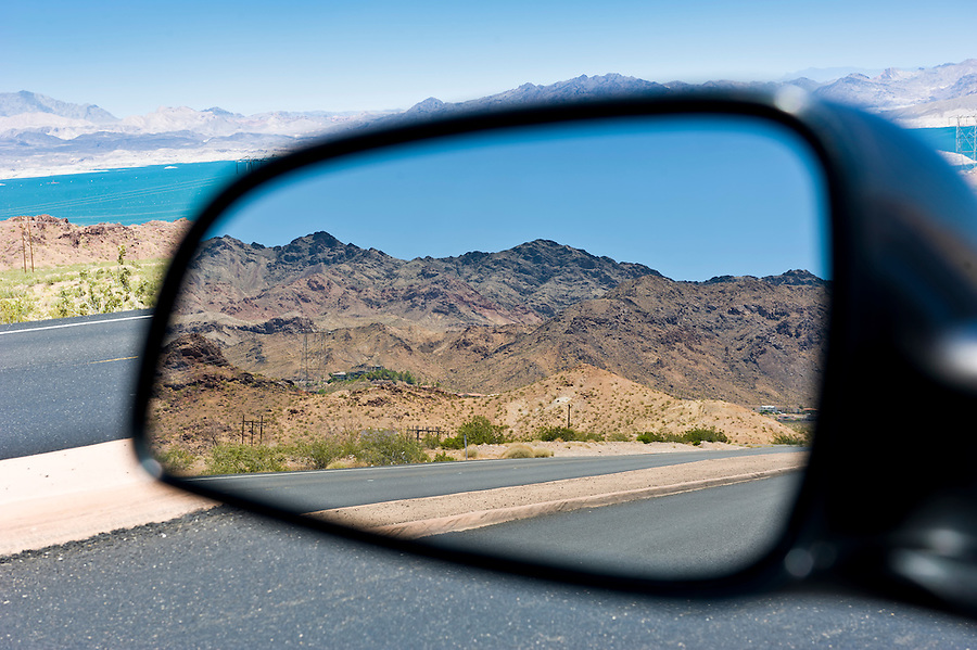 Landscape reflection in car rearview mirror in arizona