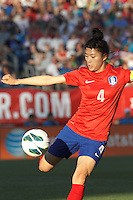 Korea Republic defender Shim Seoyeon (4) clears the ball.  In an international friendly, the U.S. Women's National Team (USWNT) (white/blue) defeated Korea Republic (South Korea) (red/blue), 4-1, at Gillette Stadium on June 15, 2013.