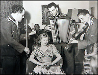 BNPS.co.uk (01202 558833)<br /> Pic: Marlows/BNPS<br /> <br /> Eva Braun being serenaded by Nazi musicians.<br /> <br /> Taken just three days before D-Day this remarkable photo shows Adolf Hitler celebrating the wedding of his brother-in-law - who he had executed a year later.<br /> <br /> The previously unseen image shows the Nazi dictator congratulating Hermann Fegelein and bride Gretl Braun, little realising that the course of the Second World War was about to turn against him.<br /> <br /> It was found in a gallery of 12 snaps of the wedding reception that lasted for thee days and was organised by Eva Braun, the elder sister of Gretl and Hitler's mistress.<br /> <br /> The fuhrer was one of the witnesses to the marriage along with SS chief Heinrich Himmler and Martin Bormann, Hitler's private secretary.<br /> <br /> The 12 black and white photos taken at her first wedding have sold at Marlows auctioneers of Stafford for &pound;400.