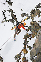 Mark Howell lead climbs a route in the Alaska range mountains, interior, Alaska.
