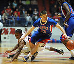 Mississippi's Jarvis Summers (32) and SMU's Jeremiah Samarrippas (12) go for the ball at the C.M. &quot;Tad&quot; Smith Coliseum in Oxford, Miss. on Tuesday, January 3, 2012. (AP Photo/Oxford Eagle, Bruce Newman)