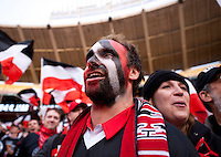 A D.C. United fan watches his team take the field before the game at RFK Stadium in Washington,DC. D.C. United tied the Houston Dynamo, 1-1.  With the tie, Houston won the Eastern Conference and advanced to the MLS Cup.