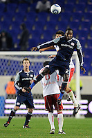 Joseph Niouky (23) of the New England Revolution and Andrew Boyens (27) of the New York Red Bulls go up for a header. The New York Red Bulls defeated the New England Revolution 3-0 during a U. S. Open Cup qualifier round match at Red Bull Arena in Harrison, NJ, on May 12, 2010.