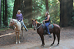 Women horseback riding at Henry Cowell Redwoods State Park