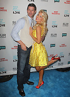 guest &amp; Gretchen Rossi.Bravo's Andy Cohen's Book Release Party For &quot;Most Talkative: Stories From The Front Lines Of Pop Held at SUR Lounge, West Hollywood, California, USA..May 14th, 2012.full length yellow dress  white sash ribbon waist red shoes leg foot up jeans denim waistcoat beige blue shirt.CAP/ADM/KB.&copy;Kevan Brooks/AdMedia/Capital Pictures.