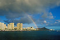 Diamond Head, Waikiki hotels and Ala Wai Yacht Harbor with rainbow from Magic Island Beach Park; Honolulu, Oahu, Hawaii.